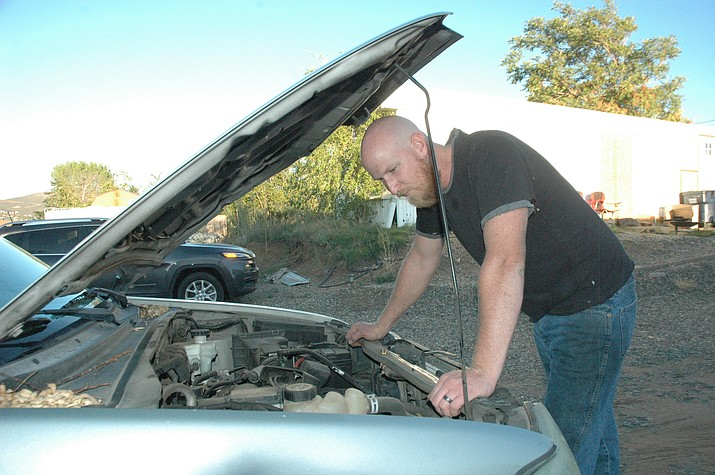 Local mechanic Cameron Clark checks out a car's engine. There are several indicators from dashboard lights to sounds that can be hints as to what needs to be addressed on your vehicle. (Jason Wheeler/Courier)