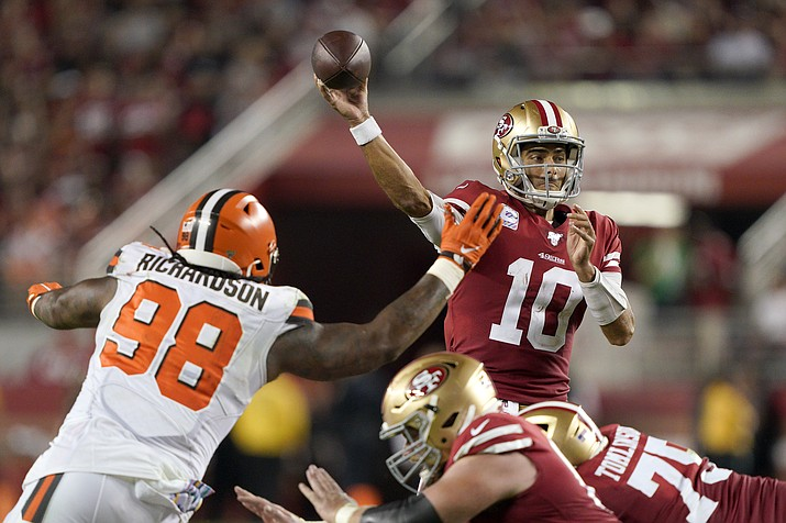 San Francisco 49ers quarterback Jimmy Garoppolo (10) passes as Cleveland Browns defensive tackle Sheldon Richardson (98) applies pressure during the second half of an NFL football game in Santa Clara, Calif., Monday, Oct. 7, 2019. (Tony Avelar/AP)