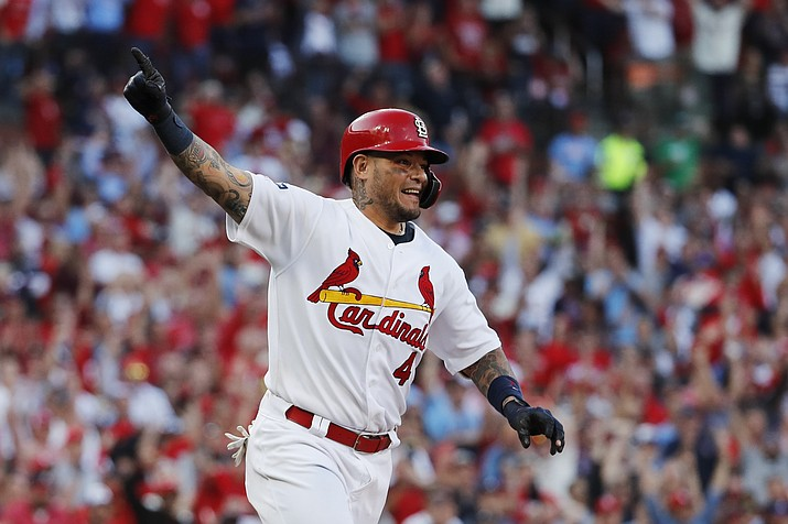St. Louis Cardinals' Yadier Molina reacts after hitting an RBI-single during the eighth inning in Game 4 of a baseball National League Division Series against the Atlanta Braves, Monday, Oct. 7, 2019, in St. Louis. (Jeff Roberson/AP)