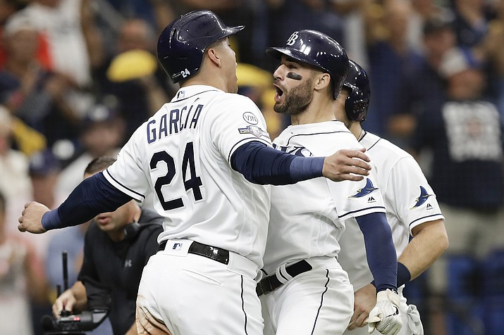 Tampa Bay Rays' Kevin Kiermaier, right, celebrates his 3-run home run in the second inning against the Houston Astros with Avisail Garcia (24) during Game 3 of a baseball American League Division Series, Monday, Oct. 7, 2019, in St. Petersburg, Fla. (Chris O'Meara/AP)