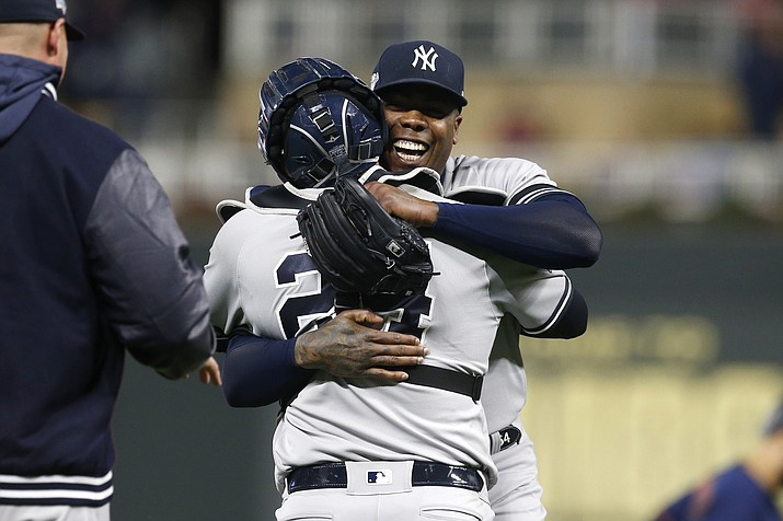 New York Yankees relief pitcher Aroldis Chapman, right, celebrates with teammate Gary Sanchez after their team's 5-1 victory over the Minnesota Twins in Game 3 of a baseball American League Division Series, Monday, Oct. 7, 2019, in Minneapolis. (Jim Mone/AP)
