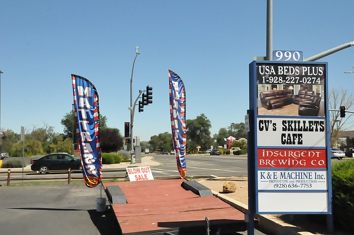 Feather flags like these seen in August on the southwest corner of Road 2 North and Highway 89 in Chino Valley have stirred a controversy between some business owners and the town's Development Services Department about their use. (Doug Cook/Review, File)