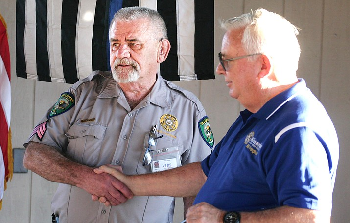 Tim Wiggle, left, a volunteer with the Camp Verde Marshal's Office, receives the department's 2019 Law Enforcement Service Award from Bill Pangburn, community services chairman for the Camp Verde Kiwanis. Wiggle is supervisor of CVMO's Volunteers in Policing division. VVN/Bill Helm