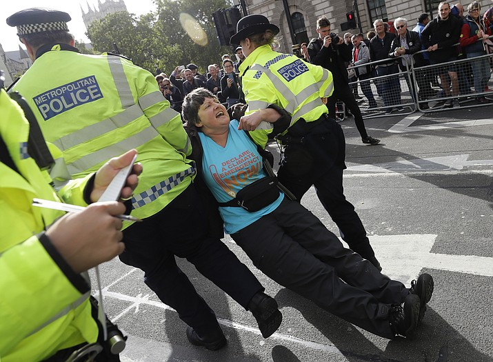 Police arrest a climate demonstrator on Whitehall in London, Tuesday, Oct. 8, 2019. Police are reporting they have arrested more than 300 people at the start of two weeks of protests as the Extinction Rebellion group attempts to draw attention to global warming. (Kirsty Wigglesworth/AP)