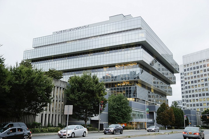 In this Sept. 12, 2019, file photo, cars pass Purdue Pharma headquarters in Stamford, Conn. Local government lawsuits against the family that owns Purdue Pharma should be allowed to proceed even as the company attempts to reach a nationwide settlement in bankruptcy court over the toll of the opioids crisis, according to a court filing on Wednesday, Oct. 2, 2019. (AP Photo/Frank Franklin II, File)