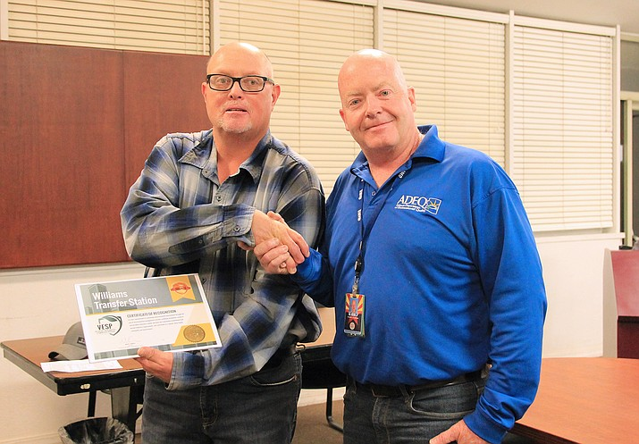 Jeff Pettit, foreman for the Williams Transfer Station accepts a VESP award from ADEQ at a September City Council meeting. The award recognizes the agency for going above and beyond environmental law requirements.  (Wendy Howell/WGCN)