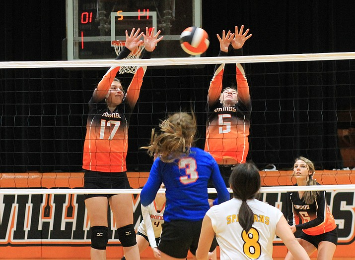 Shaelee Echeverria and Sydnee Mortensen attempt to block a spike from an Ash Fork player Oct. 1. (Wendy Howell/WGCN)