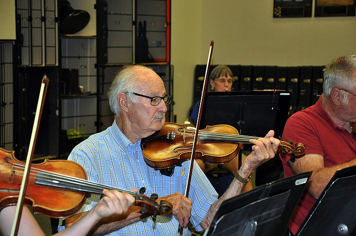 Dale Parry plays the violin in the Mohave Community Orchestra. The orchestra will present concerts at 3 p.m. on Saturday, Oct. 26 and Saturday, Dec. 7 at the Kingman High School, 4182 Bank Street. (Photo by Butch Meriwether/for the Miner)