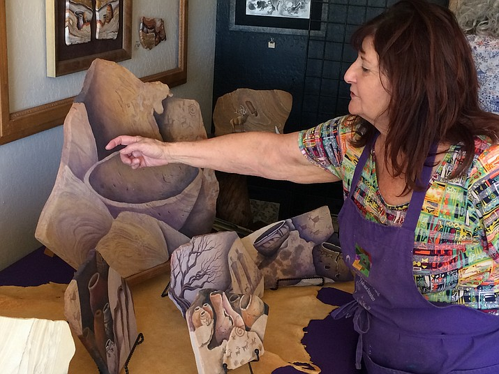 Therese Stonehart of Stonehart Art on Stone showing and talking about some of her pieces during the 12th annual Prescott Area Artist Studio Tour. (Jason Wheeler/Review)