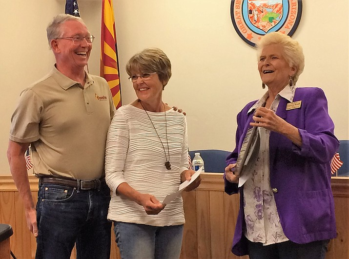 Mike and Ronnie Donovan, left, are celebrated as the 2018 Dewey-Humboldt Volunteers of the Year and accept a Certificate of Appreciation as Vice Mayor Victoria Wendt presents them to the audience at the Oct. 1 Dewey-Humboldt Town Council meeting. A plaque with their names engraved will hang in the Town Hall. (Sue Tone/Tribune)
