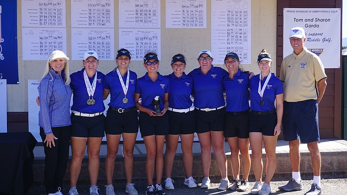Embry-Riddle women's golf (left to right: head coach Kim Haddow, Jessica Williams, Megan Hessil, Lois Sheaffer, Cami Culp, Tana House, Hannah Spiller, Kendall McBean, associated head coach Mike Haddow) pose for a photo after winning the ERAU Co-Ed Invitational on Tuesday, Oct. 8, 2019, at Antelope Hills Golf Course in Prescott. (Aaron Siple, ERAU Athletics/Courtesy)
