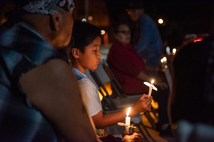 Relatives and friends of murder victims took part in a candlelight vigil at the Navajo Nation Council Chamber Sept. 25 in Window Rock, Arizona. (Photo/Office of the Speaker)