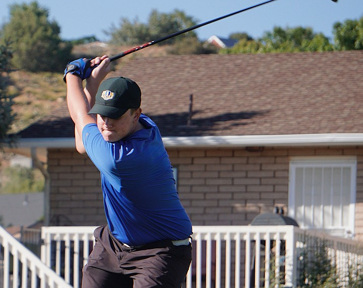 Prescott golf's Cademon Buettner tees off on the eighth hole during the team' match against Bradshaw Mountain and Coconino on Tuesday, Oct. 8, 2019, at Prescott Golf Club. (Aaron Valdez/Courier)