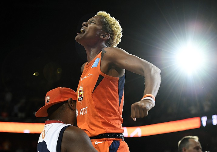 Connecticut Sun's Courtney Williams gets a lift from her father Don Williams after the Sun defeated the Washington Mystics in Game 4 of the WNBA Finals, Tuesday, Oct. 8, 2019, in Uncasville, Conn. (Jessica Hill/AP)