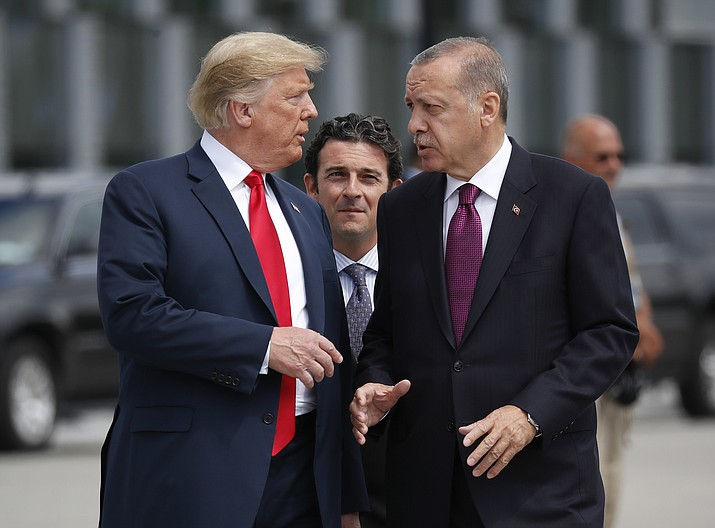 In this Wednesday, July 11, 2018, file photo, President Donald Trump, left, talks with Turkey's President Recep Tayyip Erdogan, as they arrive together for a family photo at a summit of heads of state and government at NATO headquarters in Brussels. The White House says Turkey will soon invade Northern Syria, casting uncertainty on the fate of the Kurdish fighters allied with the U.S. against in a campaign against the Islamic State group. (AP Photo/Pablo Martinez Monsivais, File)