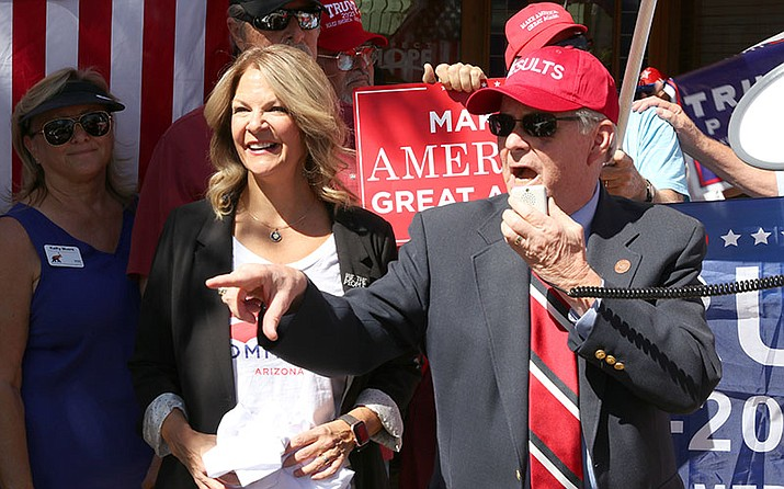 Arizona Republican Party chairwoman Kelli Ward and state Sen. Vince Leach, R-Tucson, lead the rally in front of Rep. Tom O'Halleran's office in Casa Grande. (Photo by Annika Tomlin/Cronkite News)