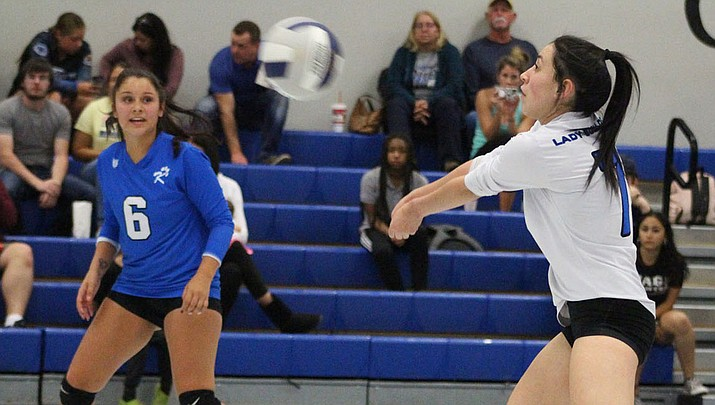 Kingman High's Elvira Torres makes a pass as Emilee Araya looks on during a match earlier this season. The Lady Bulldogs picked up a 3-2 win over Chino Valley on Tuesday night. (Daily Miner file photo)