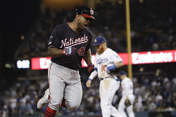 Washington Nationals' Howie Kendrick celebrates after a grand slam against the Los Angeles Dodgers during the 10th inning in Game 5 of a baseball National League Division Series on Wednesday, Oct. 9, 2019, in Los Angeles. (Marcio Jose Sanchez/AP)