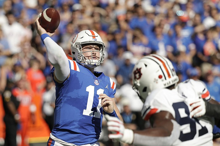 Florida quarterback Kyle Trask (11) throws a pass over Auburn defensive end Nick Coe (91) during the first half of a game, Saturday, Oct. 5, 2019, in Gainesville, Fla. (John Raoux/AP)