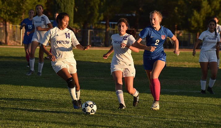 Camp Verde sophomore Annabella Cooper dribbles through the Payson defense during the Cowboys' 2-0 win over the Longhorns on Tuesday at home. VVN/James Kelley