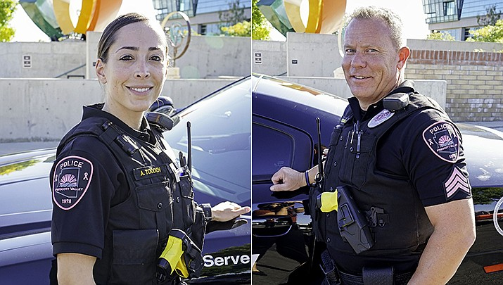 Officer Amanda Todden and Sgt. Shawn Caswell display the pink patches being worn by Prescott Valley Police during Breast Cancer Awareness Month in October to raise public awareness about the importance of early detection and to raise funds for research and treatment. (Town of Prescott Valley/Courtesy)