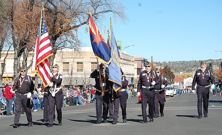 The 2018 Veterans Day Parade — including vintage automobiles, floats, horses, bands and more — makes its way around the courthouse plaza in downtown Prescott on Saturday, Nov. 10. (Tim Wiederaenders/Courier)