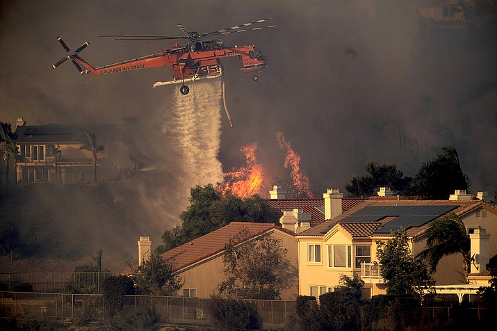 Los Angeles authorities say about 100,000 people have been ordered to evacuate their homes because of a wildfire on the northern edge of the city in the San Fernando Valley area. (Oct. 11)