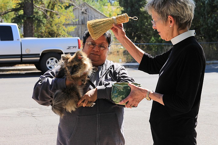 Pimi Barrozo-Bennett brings her dog to the annual Blessing of the Animals. (Wendy Howell/WGCN)
