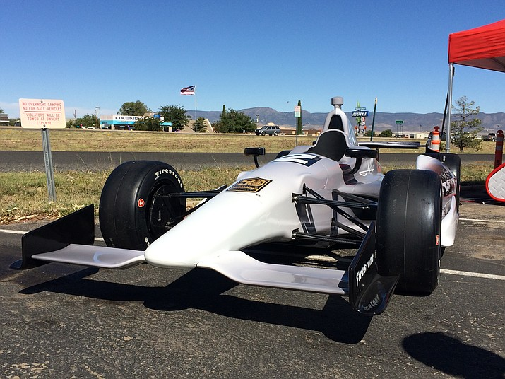 An Indy car, commemorating Mario Andrettis' 50th anniversary for his first Indy 500 win, is on display outside of Sun Valley Tires, 8337 E. Highway 69, Friday, Oct. 11, 2019. (Jason Wheeler/Courier)