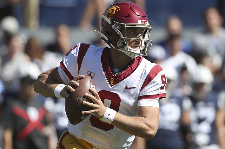 In this Sept. 14, 2019, photo, quarterback Kedon Slovis looks to pass the ball during the second half against BYU in a game in Provo, Utah. Slovis will return from injury to start for Southern California at No. 9 Notre Dame on Saturday night. USC coach Clay Helton made the announcement Tuesday night, Oct. 8, after practice. (George Frey/AP, File)