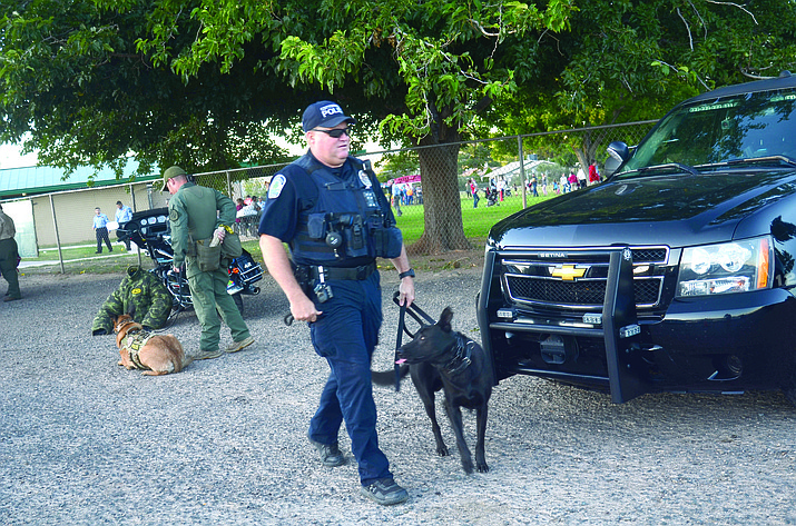 Cottonwood Police K-9 officer Cory Shilling walks Kratos toward spectators at the department's recent National Night Out event. Shilling, Kratos and other officers have been assigned to one of nine neighborhood zones in order to help build more of a sense of ownership between citizens and CPD. VVN/Vyto Starinskas