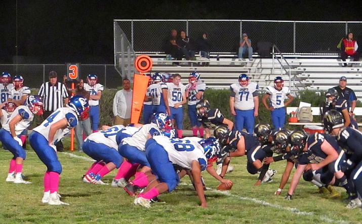 The Camp Verde Cowboys' offense lines up against the Parker Broncs defense Oct. 11 in Parker. The Cowboys couldn't get much of anything going, they did score twice in the fourth quarter in a 46-14 loss. Photo by John Gutekunst