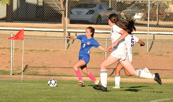 Camp Verde junior Bridgette Fitzgerald crosses the ball during the Cowboys' 2-0 win over Payson on Tuesday. CV closed out their home schedule with a pair of wins last week. VVN/James Kelley