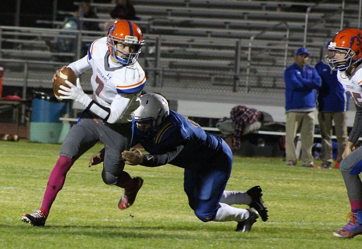 Chino Valley QB Tyler Carey (7) breaks the tackle in the team's 20-16 loss to Kingman on Friday, Oct. 11, 2019, in Kingman. (Beau Bearden/Kingman Daily Miner)