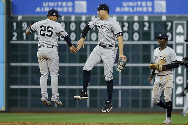 New York Yankees second baseman Gleyber Torres, left, and right fielder Aaron Judge celebrate after their win against the Houston Astros in Game 1 of the American League Championship Series Saturday, Oct. 12, 2019, in Houston. (Matt Slocum/AP)