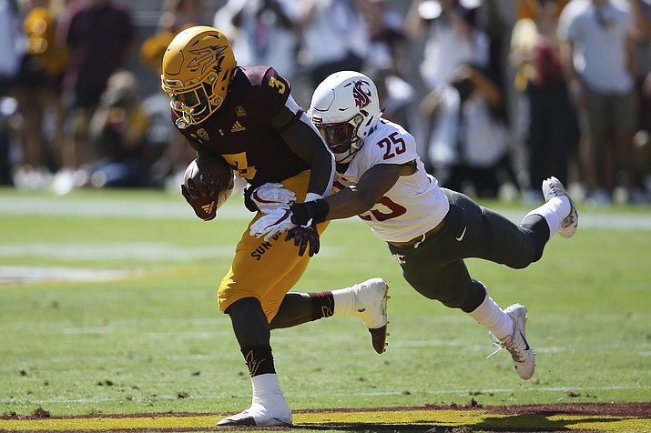 Arizona State running back Eno Benjamin (3) is pulled down by Washington State safety Skyler Thomas (25) during the first half of a game Saturday, Oct. 12, 2019, in Tempe. (Ross D. Franklin/AP)