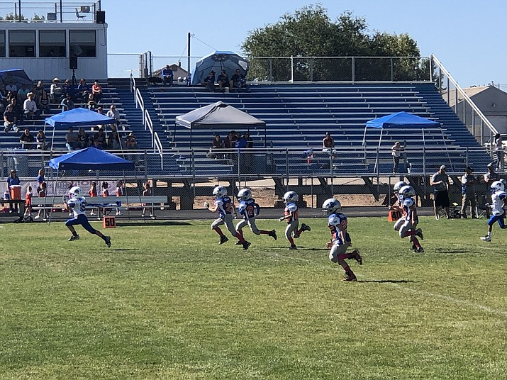 Kellen Hudak, far left, of the Prescott Badgers mighty mites football team runs down the field to score an 86-yard touchdown during the team's 31-0 win over Chino Valley on Saturday, Oct. 12, 2019, at Chino Valley High School. (Jessica Anderson/Courtesy)
