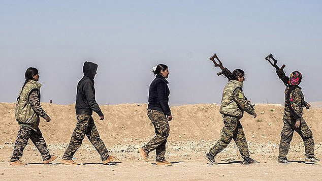 Women in a military council of Kurds, Christians, Arabs, Turkmen, Yaazidis and others are shown in northwest Syria in 2017. Arizona lawmakers have joined in the condemnation of U.S. President Donald Trump's decision to pull back U.S. troops to make way for a Turkish incursion in Syria. (Photo by Master Sgt. Mark Burrell/U.S. Army)