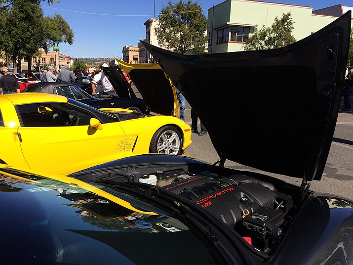 Corvettes with their hoods up at the 13th annual Prescott Vette Sette Car Show in downtown Prescott Saturday, Oct. 12. (Jason Wheeler/Courier)