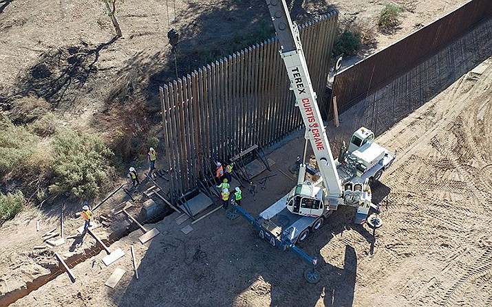 Workers repair a section of border wall near Calexico, Calif., in this 2018 photo.  A federal judge ruled that President Donald Trump's declaration of a national emergency to divert $3.6 billion in Pentagon funds to the wall – including $1.3 billion for Yuma-area projects – was unlawful. (Photo by Mani Albrecht/U.S. Customs and Border Proection)