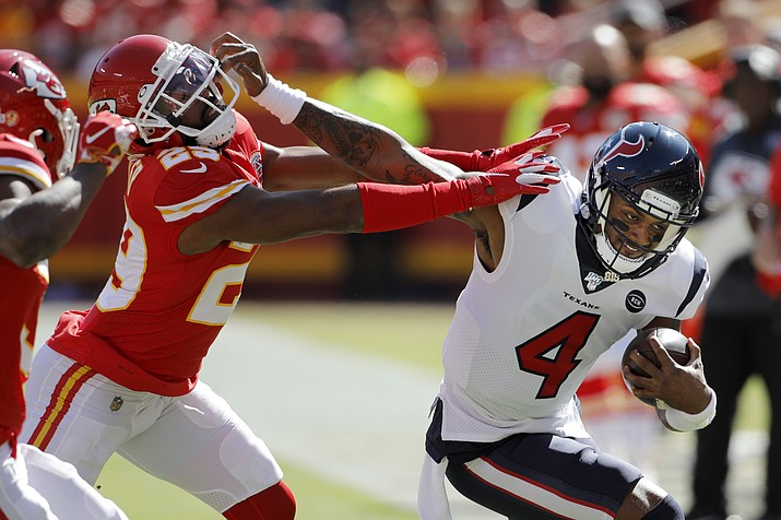 Houston Texans quarterback Deshaun Watson (4) is tackled by Kansas City Chiefs cornerback Kendall Fuller (29) during the first half of an NFL football game in Kansas City, Mo., Sunday, Oct. 13, 2019. (Colin E. Braley/AP)
