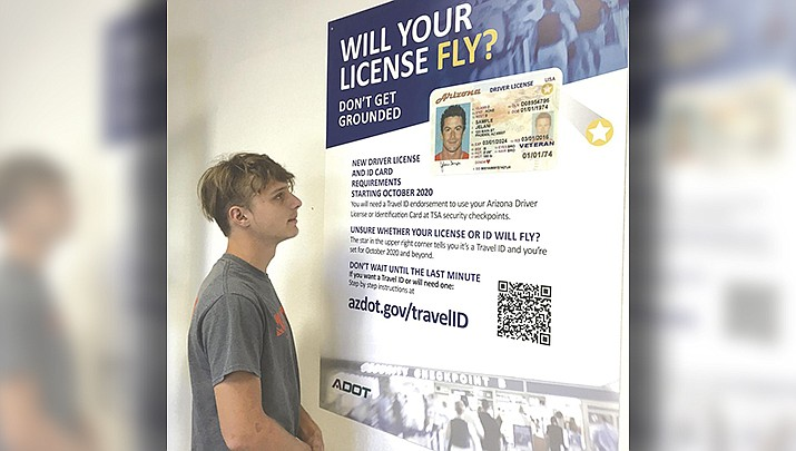 Austin Belt took a few moments to read a poster detailing the Arizona Travel ID when he visited the Arizona Department of Motor Vehicles in Lake Havasu City last week. (Photo by Pam Ashley/Today's News-Herald)