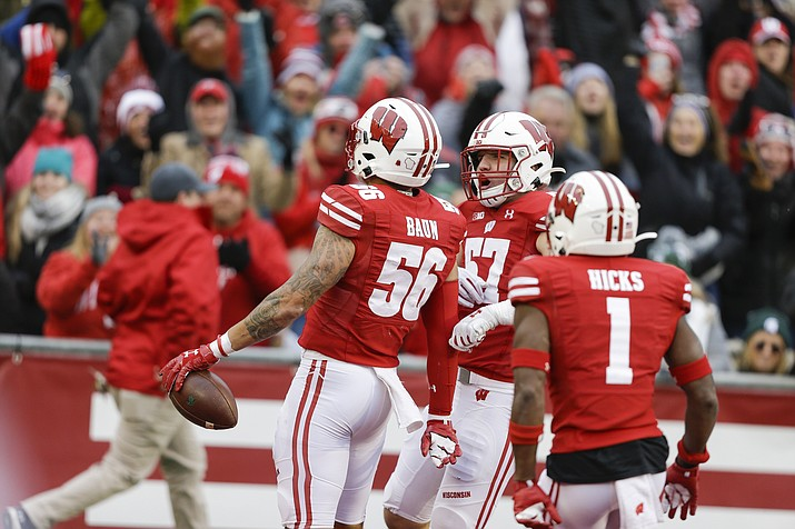 Wisconsin linebacker Zack Baun (56) celebrates an interception with teammates linebacker Jack Sanborn (57) and cornerback Faion Hicks (1) during the second half of an NCAA college football game against Michigan State Saturday, Oct. 12, 2019, in Madison, Wis. Baun scored a touchdown on the interception. Wisconsin won 38-0. (Andy Manis/AP)