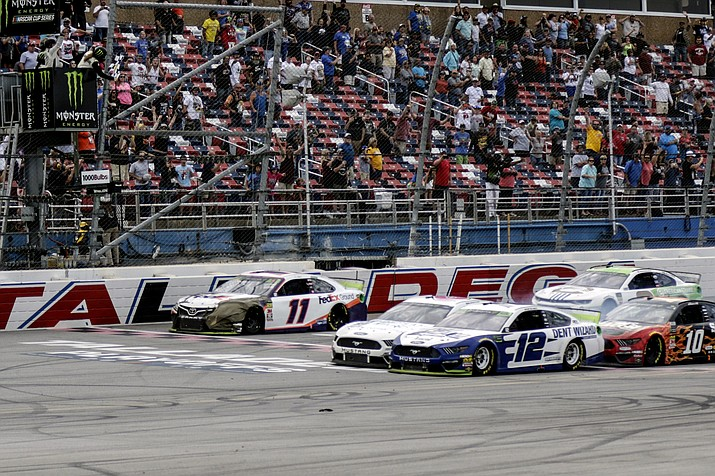 Ryan Blaney (12) narrowly slides by driver Ryan Newman (6) to take the checkered flag in a NASCAR Cup Series auto race at Talladega Superspeedway, Monday, Oct 14, 2019, in Talladega, Ala. (Amanda Newman/AP)