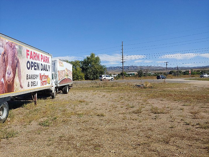 A semi-truck trailer and a truck advertise Mortimer Farms, which stands due south of Highway 169 from a proposed 197-unit, ranch-style apartment complex at the northeast corner of highways 69 and 169. (Doug Cook/Prescott News Network)