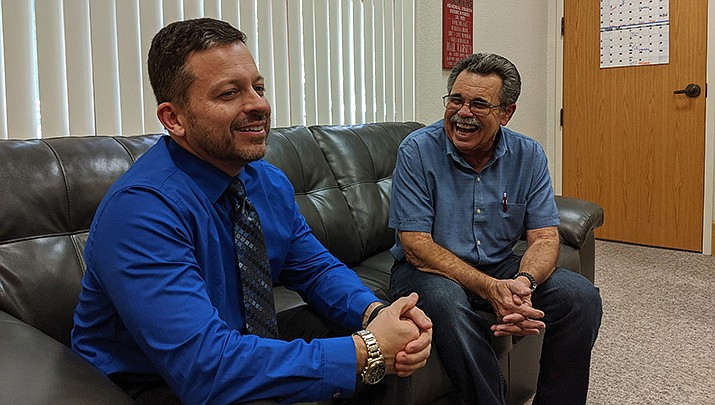 Judge Jeffrey Singer, left, and soon-to-be member of the Arizona Veterans Hall of Fame Jim Consolato share a laugh on Monday, Oct. 14. (Photo by Travis Rains/Daily Miner)