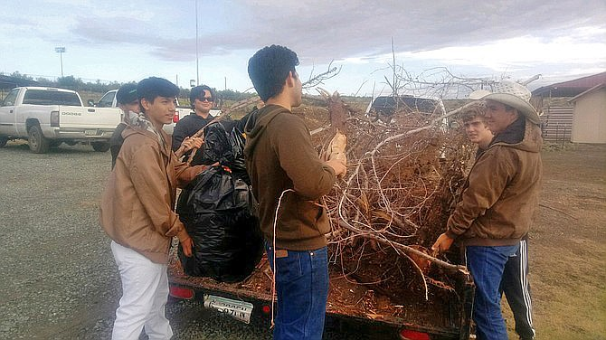 Mayer students load a trailer of garbage from an elderly resident's yard. (YCSO/Courtesy)