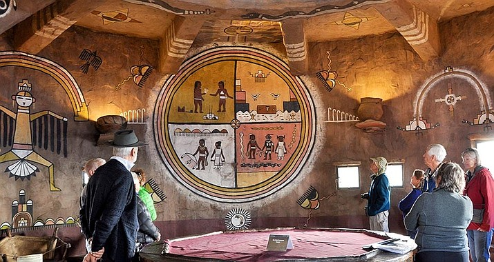 Visitors view murals on the second floor of Desert View Watchtower after the completion of conservation work. The murals were painted by Hopi artist Fred Kabotie in 1932. (Photo/NPS)
