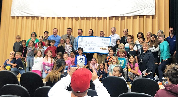 Bearizona CEO Sean Casey presents a $30,000 check to Williams Elementary-Middle School for its Falcon Flyers after-school program. (Submitted photo)
