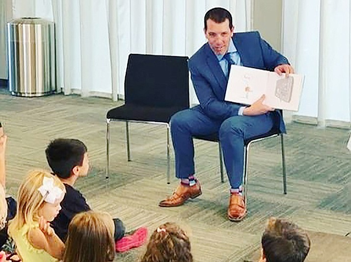 Mayor Kell Palguta reads to children at the Prescott Valley Library on Wednesday, Oct. 9, 2019. (Courtesy)